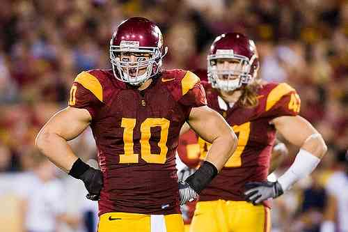 "Very few ""True"" Freshman even see the field in college football. Brian Cushing (#10) earned a starting role for USC as a Freshman."